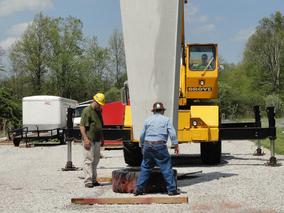 Emmett cranes up this section for access to the bottom for a PreKote treatment. Painting a Rosati Sculpture