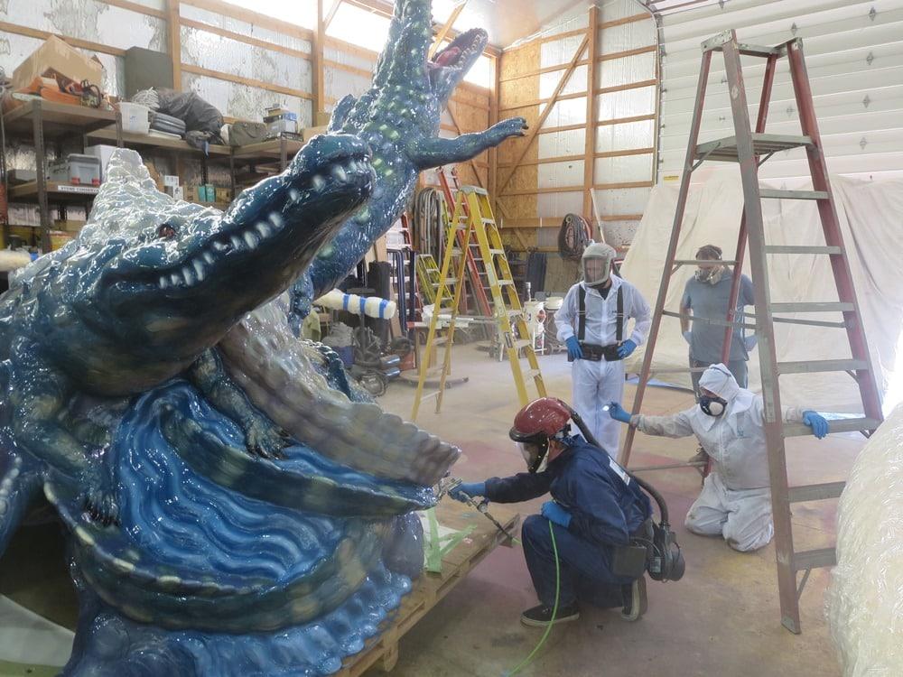 Final clear coating of the restored Luis Jimenez LOS LAGARTOS from El Paso, Texas.