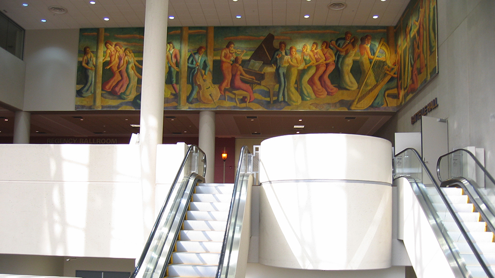 All of the canvas sections that form the continuous scene of dancers and musicians depicted in the 70 foot mural have been installed by McKay Lodge, Inc., for public viewing above the entrance to the ballroom of Battelle Hall of the Greater Columbus Convention Center.