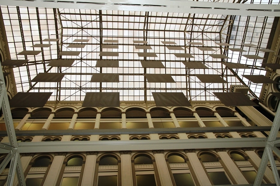 Looking upwards toward atrium roof showing the very dirty artwork of Robert Irwin before conservation treatment