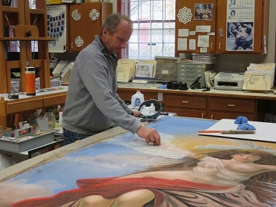 Paintings Conservator Stefan Dedecek cleaning Mid-day from the woodward opera house